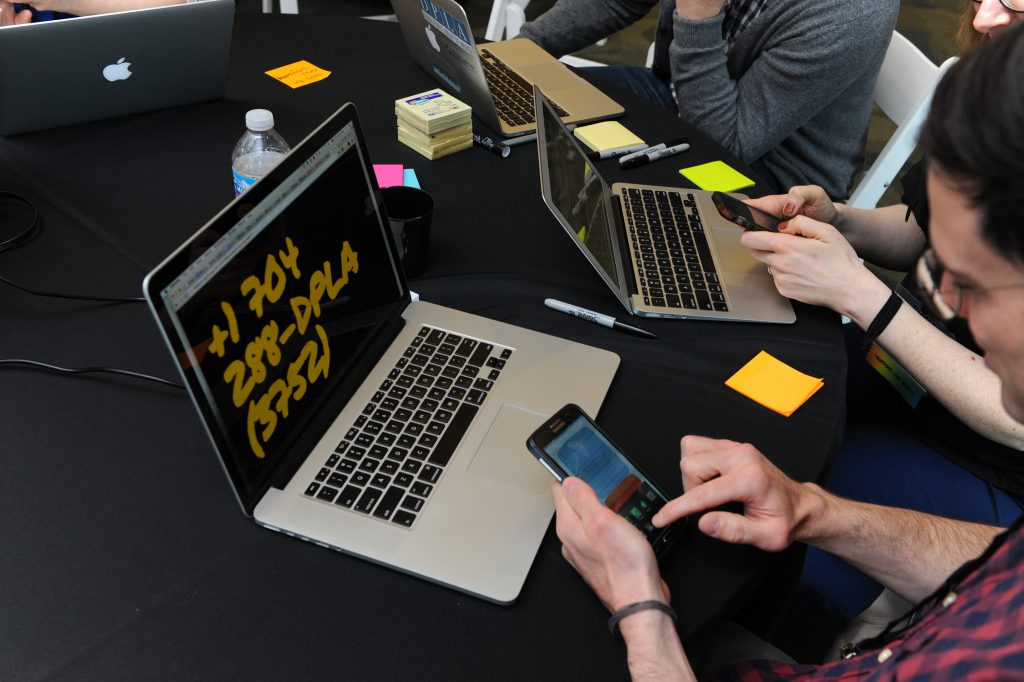 Working with Mark Matienzo's Dial-a-DPLA app during the DPLAfest hackathon.